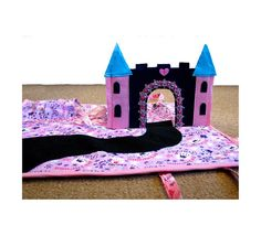 Welcome to my world of fantasy play.    This little handbag folds out into a playmat with a pop-up castle for a 3D play session and is light and
