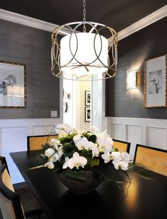A great example of how a painted ceiling looks FABULOUS! Wallpaper with wainscoting and a pop of color on the dining chairs. Love the sophistication of this room for a formal dining!