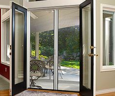 The Escape retractable screen doors are self-adjusting to fit uneven openings. Reinforced magnetic seal to keep door closed. Adjustable from to Standard door height Hardware included. Double Patio Doors, Double Doors Interior, Double Front Doors, Interior Barn Doors, Modern Patio Doors, French Doors Patio, French Interior, Front Door With Screen, French Doors With Screens