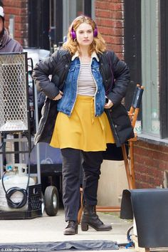 Retro chic: The 26-year-old stunner teamed a striped top with a retro denim jacket and a y...
