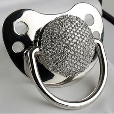 The Diamond Pacifier Keepsake Diamond Pacifier Product Description The diamond pacifier is exactly what everyone in Hollywood talks about. This exclusive diamond pacifier is the newest trend in celebrity baby gifting. This Sparkly Diamond Pacifiers Baby Bling, Bling Bling, Blue Ivy, Rocker, Most Expensive, Expensive Taste, Everything Baby, Angelina Jolie, Shiloh Jolie