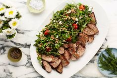 This pork tenderloin dinner comes together fast, but is packed with the bright flavors of citrus and dill. Peas and lightly blistered tomatoes add sweetness while feta cheese adds tang to the farro and arugula salad.