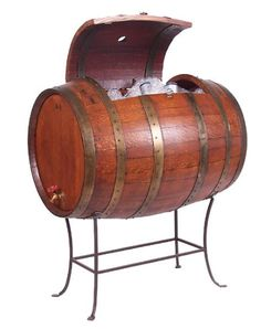 Fill this full wine barrel cooler with ice and put in your favorite drinks to chill. Made from a recently retired wine barrel, this cooler has a hinged lid, a brass drain spout, and graceful wrought iron legs. What a great conversation piece. Western Kitchen Decor, Western Decor, Country Decor, Wine Country, Country Living, Wine Barrel Furniture, Rustic Furniture, Furniture Ideas, Furniture Inspiration