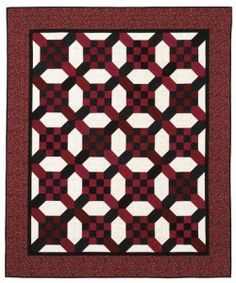 """Here's a free quilt pattern to make your own Quilt of Valor. Donated by 12-time author Nancy Mahoney, """"Square Crossing"""" features easy strip-piecing and folded-corner techniques. Make the quilt as shown, or substitute blue fabrics for the black pieces."""
