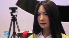 Beautiful lifelike robot girl at World Robot Conference, Beijing