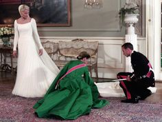 Queen Sonja and Prince Haakon fix Princess Mette-Marit's wedding dress. I thought this was a lovely photo.