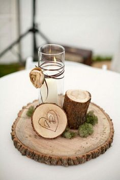 simple country wedding centerpiece with tree stumps