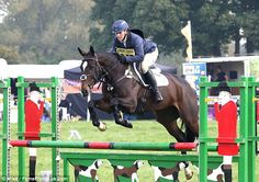 Zara Phillips Tindal and her horse clear the jump during the showjumping section of the Dauntsey trials