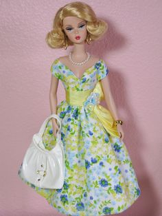 Barbie.. I love this sophisticated Baby Doll styled dress, with a bit of a 60's style to the dress... i would totally wear that kind of dress every day, and im not a dress person!