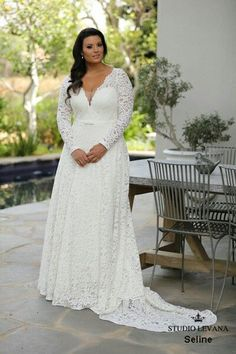 Seline-plus size lace wedding gown with long sleeves. Such a stunner!