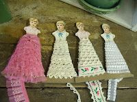 I'll never pass-up another paper doll...what a great way to display lace
