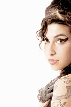 Amy Winehouse photographed by Denny Renshaw in 2007.