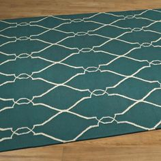 Soho Dhurrie Rug Hip & hot! Clean lines and cool colors are sophisticated chic! Quatrefoil pattern adds to the sophistication of this best selling rug!