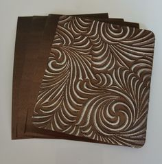 Brown craft metal.  Hand and Machine emboss.  Available in different sizes at www.creaticcastudio.co.za