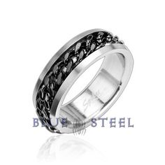 PIN IT TO WIN IT! Moon Crest Black: A solid chain of black twisted steel is is shackled around the center of the indented band. The stainless steel chained ring captures the spirit of the greatest and most forward thinking minds  $29.99  www.buybluesteel.com