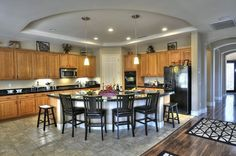 nice big kitchen with curved counter and matching recessed ceiling.  Also like the tile and wood flooring    PHX
