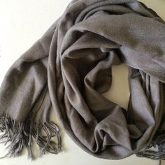 Gray scarf Gray scarf with fringe ends a couple pulled threads not very noticeable Accessories Scarves & Wraps