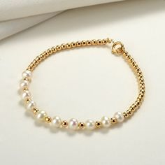 Gold Plated Beads and White Pearl Strand Bracelet