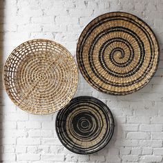 I love decorating with baskets! This would look great on the white brick in my house
