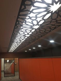 Laser cut suspended ceiling - Intu Shopping Centre, Gateshead. Star flower design by Miles and Lincoln. www.milesandlincoln.com