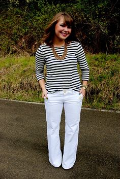 Stripes, flattering white pants, and a statement necklace...great outfit!