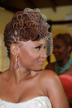 This is such a lovely style! Pin-curled locs with a basket weave in the back. (Photo courtesy of Karl Anderson, as seen on munaluchibridal.com
