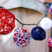 Oh say can you see – the patriotic lighting at your next Fourth of July gathering. These red, white and blue globes made of yarn are so fun to assemble, the whole family will want to join in. Besides being festive string light covers, these yarn globes make great garlands, or can simply be displayed in a bowl as a table decoration.