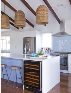 An island kitchen with the outstanding blue splash-back!