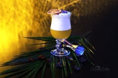 The Eggxecutor from @Budapest_Cocktails in Hpnotiq Budapest  Gin Coconut eggfoam Pineapple puree Pineapple juice Lime juice Anise star Dried levandel Dried Orange
