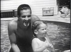 Robert Cummings plays with his daughter in the pool (he had 7 children)