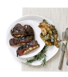 This Roasted Garlic Roquefort Stuffed Flank Steak recipe features a tender cut of meat stuffed with a slightly sweet, slightly bitter and extremely flavorful cheese sauce with the ever-satisfying addition of roasted garlic. (Photo by Jennifer Silverberg) Paleo Recipes, Dinner Recipes, Dinner Ideas, Flank Steak Recipes, Easy Eat, Roasted Garlic, Dinner Tonight, Cheese Sauce, Entrees