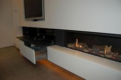 Great to have storage under the fireplace. Tv Over Fireplace, Home Fireplace, Modern Fireplace, Living Room With Fireplace, Fireplace Design, Fireplaces, Living Room Wall Units, Living Room Designs, Foyers