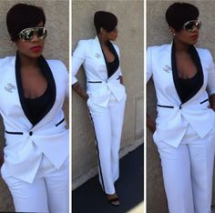 Fantasia know she killin' it in a white suit with black side stripe on pants and black accents at top of pockets on jacket; YEAH! definitely me!
