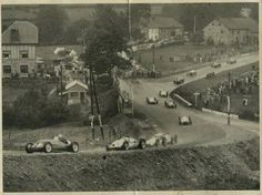 "Found this picture of the Raidillon Complex at the circuit of Spa - Francorchamps in 1939. Here you can still recognize the location of the ""Eau Rouge"" by the position of the stone bridge railing, next to the signpost, at the bottom."