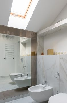 Although abnormal in the United States, bidets are common in private homes and public businesses in Argentina, Italy, Japan, Portugal, and Venezuela. Learn how to install them. Bidet Toilet Seat, Toilet Design, Wall Mounted Mirror, White Tiles, Floating In Water, Basin, Service Design, Round Mirrors, Venezuela