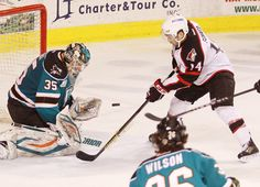 Worcester Sharks goaltender Harri Sateri makes a save on Portland Pirates forward Chris Conner (Feb. 1, 2013).