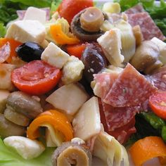 Antipasto Salad II | Two kinds of salami mix it up with two kinds of cheese, artichoke hearts, olives, tomatoes, and roasted red peppers in this colorful salad
