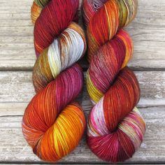 Shades of grey with red and yellow bring to mind armor, smoke, and flickering flames. While we call this a ‰Û÷Repeatable Babette‰۪, every skein and every batch is a bit different. This colorway is als