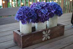 Cute wooden planter box with hydrangeas