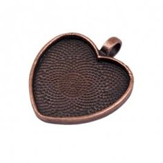 Pendant Trays - Heart.  These pendant trays are perfect for jewelry making. Easily slip and adhere your glass shape into the tray for a finished, professional look.