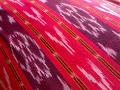 Red Ikat. Indian Fabrics. Price: 14.99 http://www.mamtamotiyani.com/product/red-ikat-fabric-by-the-yard