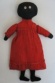 Early black cloth doll with button eyes 19