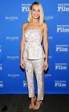 Margot Robbie in a pink brocade Prada top and pants