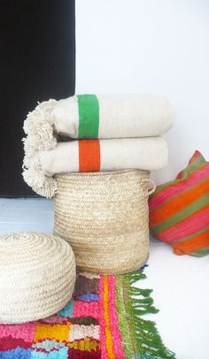 accent throws with bright orange and green stripe