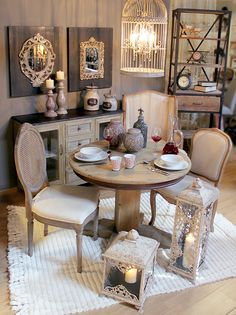 Elegant #lanterns, beautiful #chairs and a cozy table, all in neutral shades. Isn't this the perfect scene for dinner? www.inart.com
