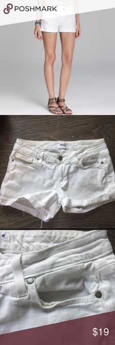 "PAIGE 24 ""JIMMY JIMMY"" WHITE DENIM SHORTS RAW EDGE PAIGE 24 ""JIMMY JIMMY"" WHITE DENIM SHORTS RAW EDGE FINISH USA 5-pocket styling. Zip fly with two button closure. Strategically distressed in all the right places. Raw edge finish. Could be cuffed or worn un-cuffeed. 99% cotton, 1% spandex blend. Machine wash Pair these stylish Paige shorts with your favorite top, add cute flats or wedges, and take the whole outfit to the next level.   Condition: Pre-owned. Smoke free, pet free household…"