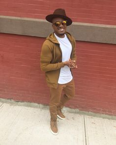 Men's Style: Brown track jacket suit, fedora hat, sunglasses