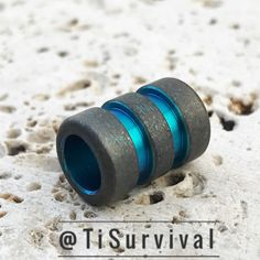 Stonewashed Grooved Lanyard Bead with Green Grooves [www.TiSurvival.com] #TiSurvival #Titanium #TiSurvivalLanyardBeads #LanyardBeads #TitaniumBeads #EDCaddict #BeadPorn #GearJunky #PocketDump #EveryDayCarry #EDC