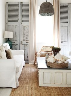 White slip covers and door coffee table.