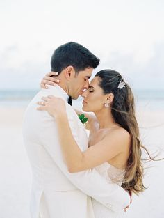 Romantic beach wedding photo of bride and groom | A stunning destination weekend wedding in Playa del Carmen | Cancun Real Weddings | LUCY MUNOZ PHOTOGRAPHY | Magnolia Rouge - Fine Art Wedding Blog